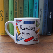 Load image into Gallery viewer, Child's size reading fuel mug scattered colourful books cup for reading Laura Lee Designs Cornwall