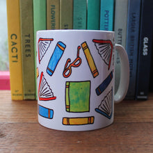 Load image into Gallery viewer, Colourful books readers fuel mug by Laura Lee Designs in Cornwall printed stoneware mug