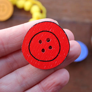 Red wooden button brooch by Laura Lee Designs in Cornwall