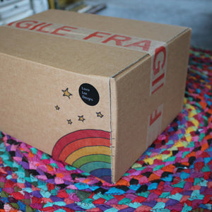 Rainbow box of sale goodies from Laura Lee Designs