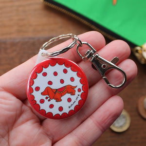 Colourful red and orange sausage dog keyring with a clip for using as a zip pull or bag charm by Laura Lee Designs Cornwall