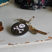 Load image into Gallery viewer, Black and white skull and crossbones steampunk goth keyring by Laura Lee Designs in Cornwall