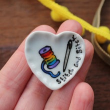 Load image into Gallery viewer, Stitch and bitch heart shaped miniature dollshouse plate with rainbow sewing thread and a needle hand painted by Laura Lee Designs Cornwall