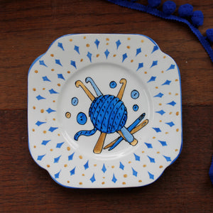 Blue and gold plate crocheting themed upcycled plate