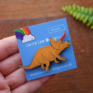 Mustard yellow rainbow dinosaur brooch by Laura Lee Designs Cornwall