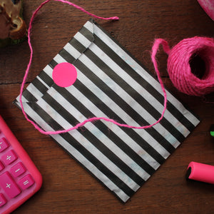 Gift wrap striped bag for notebooks with neon sticker seal
