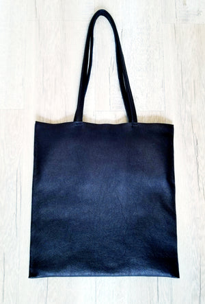 Finest packable black leather tote bag with double inside pockets.  Fits 13 inch laptop