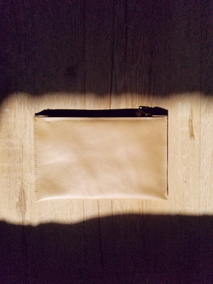 Leather zip pouch perfect for cellphones and keys and our card holders