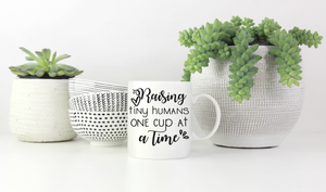 Raising tiny humans mug vinyl
