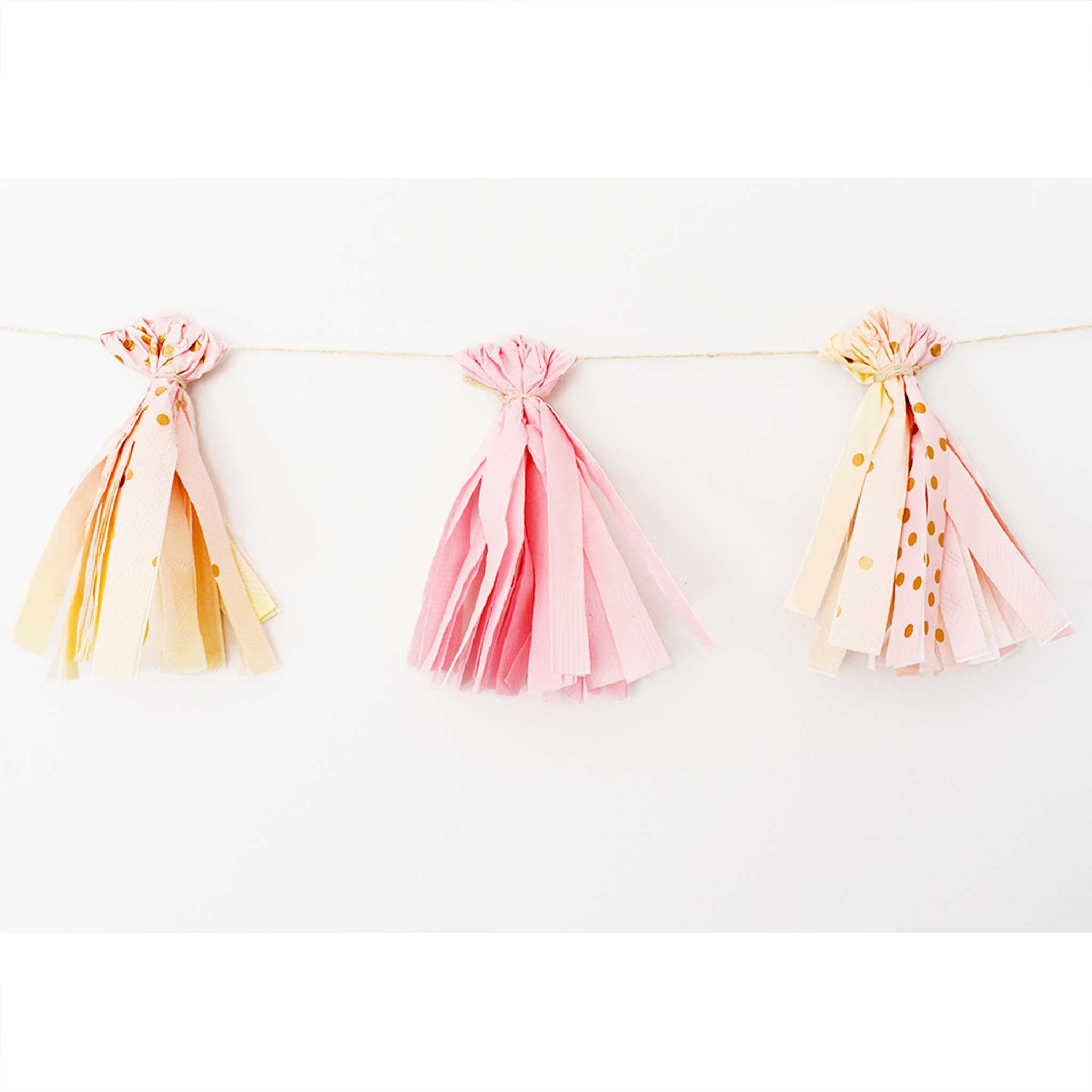 Party Hacks: How to DIY a Napkin Tassel Garland in 4 Easy Steps.