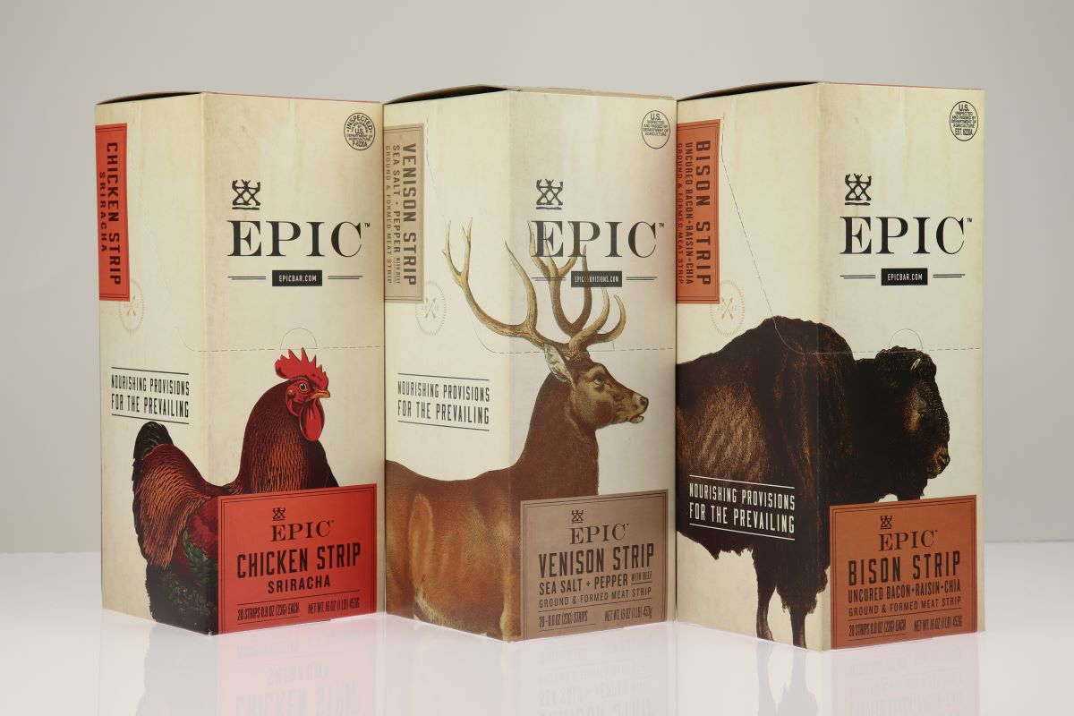 Three Epic paperboard folding cartons sitting side by side with one showing a chicken, one showing a deer, and another a bison