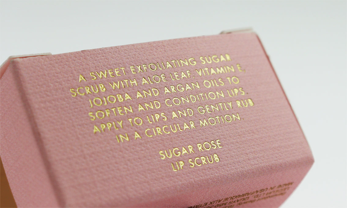 Small pink box depicting gold foil stamping on the side