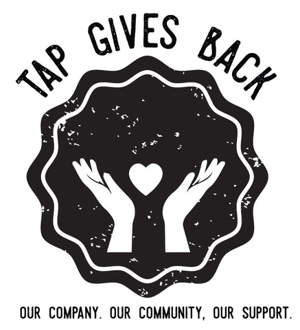Black and White Tap Gives Back Logo depicting hands and a heart