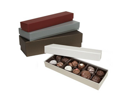 Red, Silver, and Bronze Artisan Truffle Boxes stacked on top of each other with white box in front and open with chocolates inside