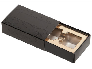 2 piece black embossed truffle slide with tray pulled out showing gold candy tray