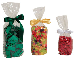 1/2 lb, 1 lb, and 2 lb cello bags filled with candy and tied with various colored ribbons