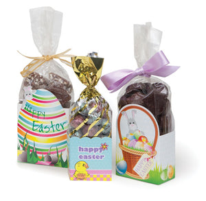 Group of three Easter cello caddies with cello bags filled with assorted chocolates and tied with ribbons