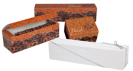 Assorted sizes and designs of the Pretzel Auto Bottom Box. A white box with silver stretch loop sits up front and three boxes decorated with chocolate-covered pretzels sit in the back. The box on the left sits open showing chocolate-covered pretzels inside.