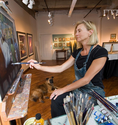 artist Carol Macconnell painting in her art studio