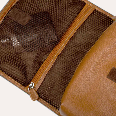 Carpe Diem men's toiletry kit with multiple pockets and coated metal clasps. Shop at Paul Adams.