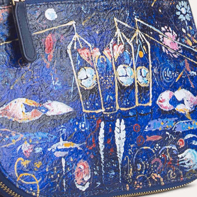 Peigi sling bag for women with original hand-painted Surrealist art on canvas. Shop at Paul Adams.