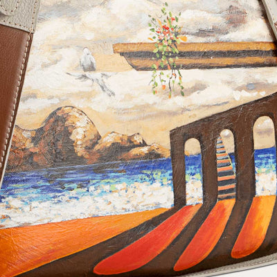 Rhea leather handbag with original hand-painted Surrealist art on canvas. Shop at Paul Adams world.