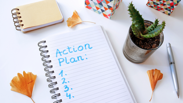 """Notebook with writing that reads """"Action Plan."""""""