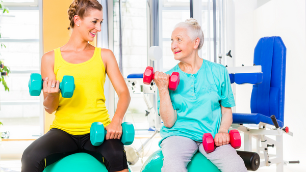 Two Women working out with dumbells