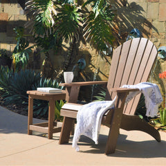 Brown PolyTEAK Adirondack chair with matching side table