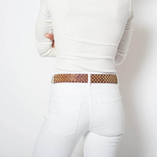 "woman wearing handmade cognac croc stamped leather 1.5"" belt for women with brass studs artwork - Calleen Cordero Designs"