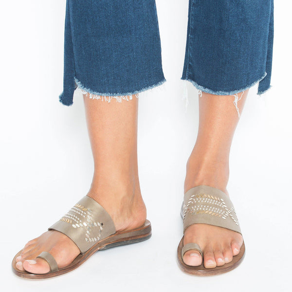 woman wearing handmade pewter enzo leather sandal for women with brass and nickel studs artwork - Calleen Cordero Designs