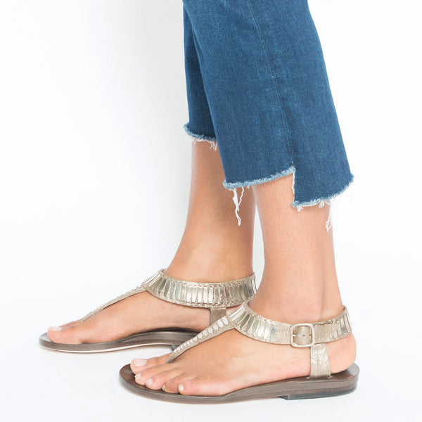 woman wearing handmade gold leather sandal for women with nickel studs artwork - Calleen Cordero Designs