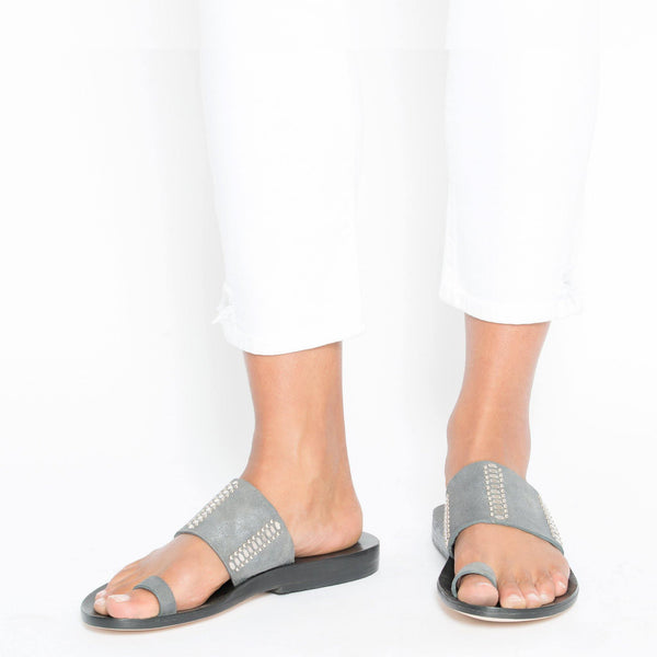 woman wearing handmade grey leather sandal for women with nickel studs artwork - Calleen Cordero Designs