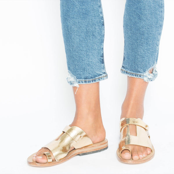 woman wearing handmade gold mirror leather sandal for women with brass studs artwork and leather sole - Calleen Cordero Designs