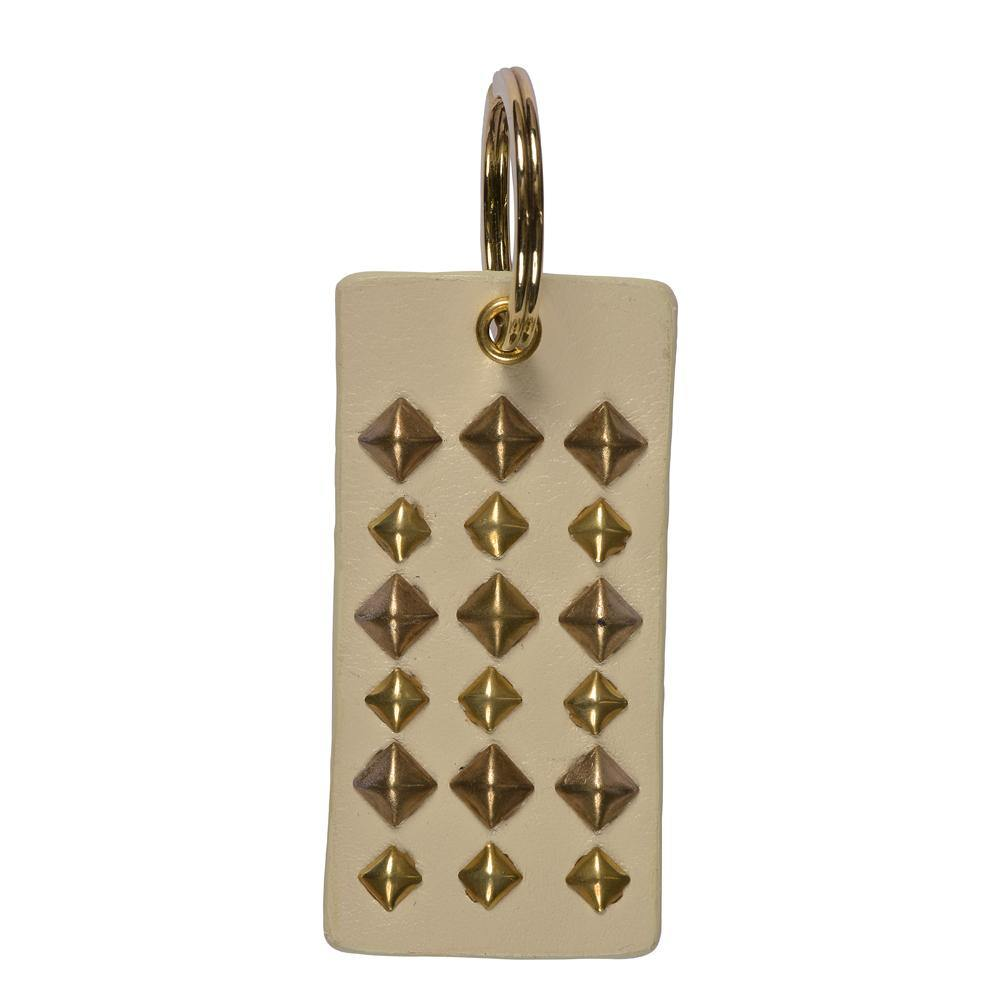 handmade white leather keychain with brass artwork