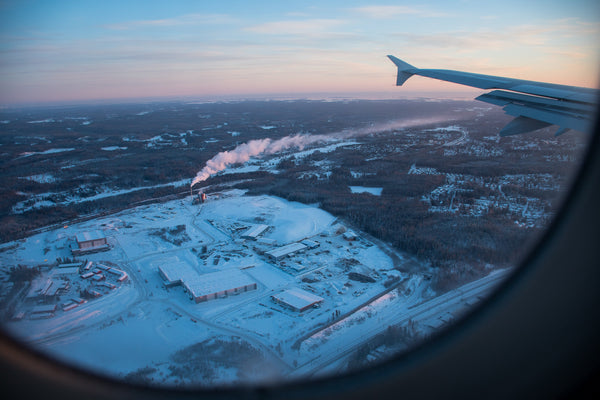 Winter Landscape through Plane Window as it Lands