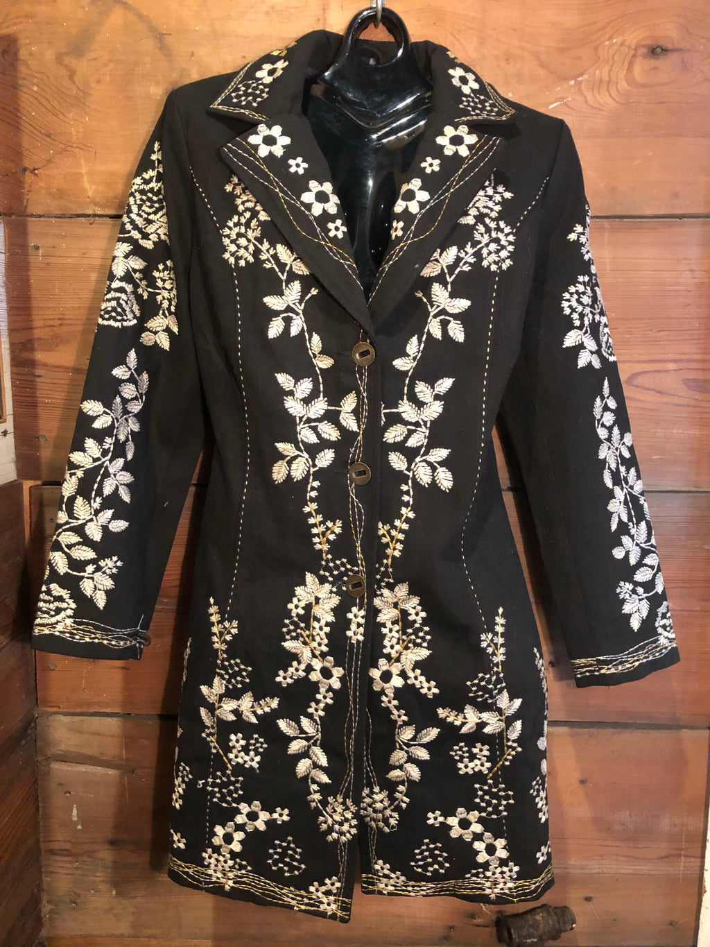 Black jacket with white embroidery