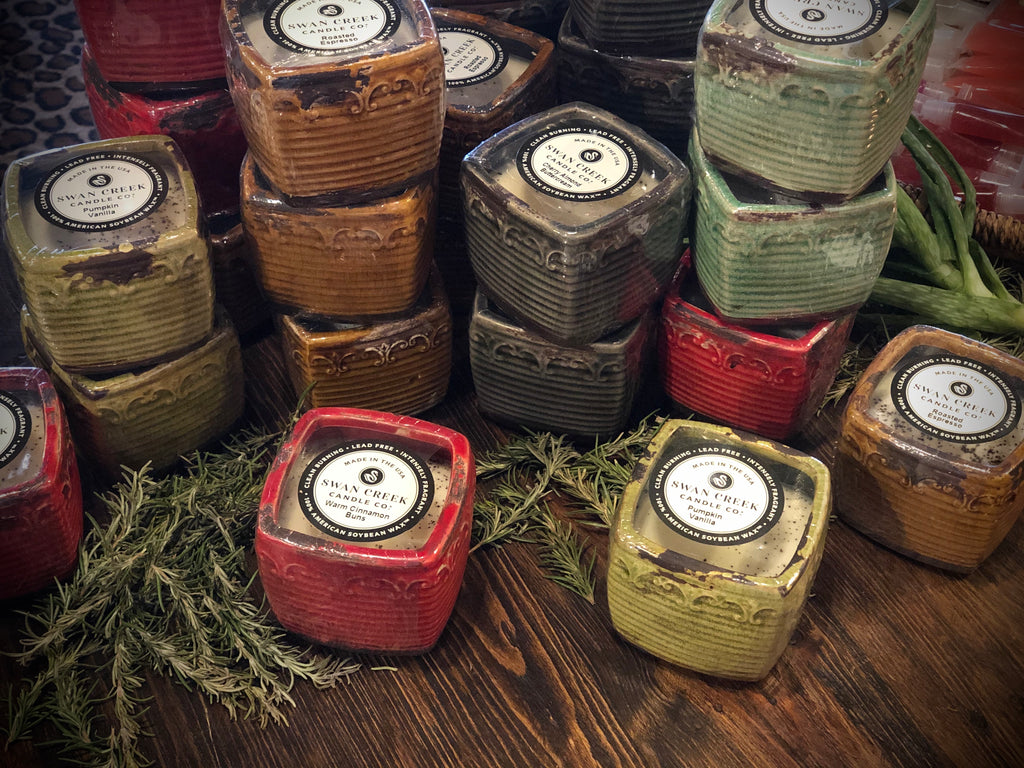 Swan Creek candles in rustic containers