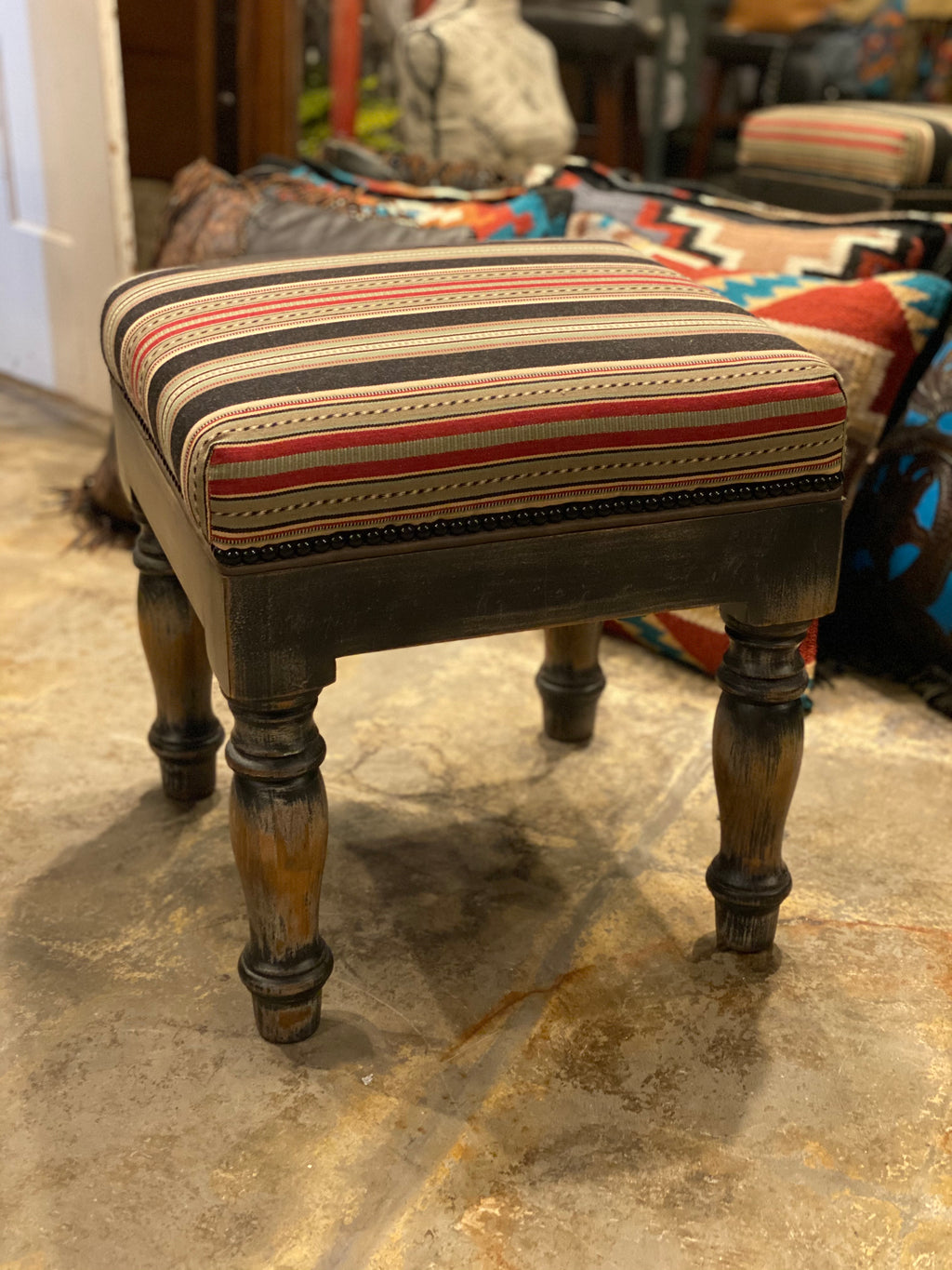 Antique square ottoman with striped fabric