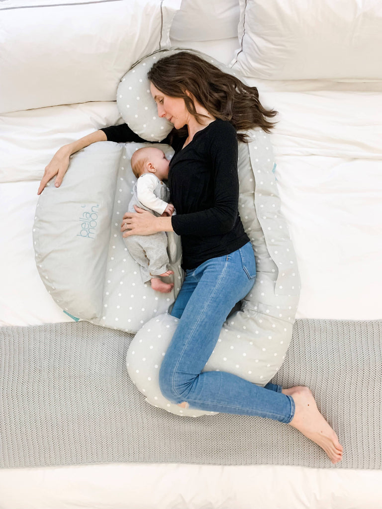 Mother using BellaMoon Full Moon to breastfeed lying down