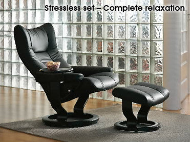 Black Stressless chair and stool for complete relaxation