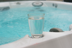 Glass of water next to hot tub