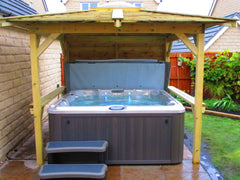 Hot Tub within wooden gazebo on patio
