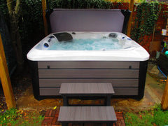 White and grey hot tub with steps