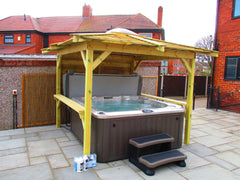 Hot Tub on patio under a wooden gazebo