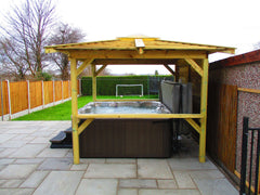 Jacuzzi hot tub under wooden gazebo