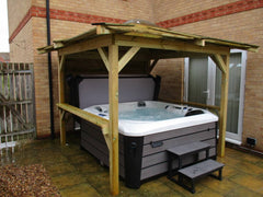 Hot Tub within gazebo on patio