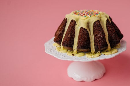 chocolate cake with custard and sprinkles