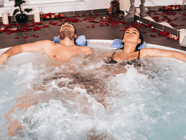 couple romantically relaxing in a hot tub