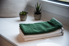 Green and white folded towels